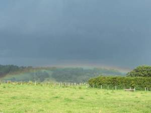 a shallow rainbow over the valley